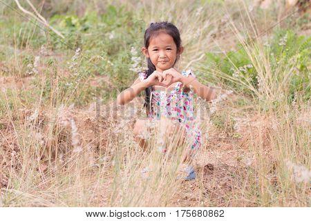 Thai girl in Grass flower field children