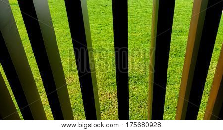 background with old wooden fence and green grass