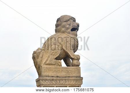Granite lion on cloud sky background in St. Petersburg Russia.