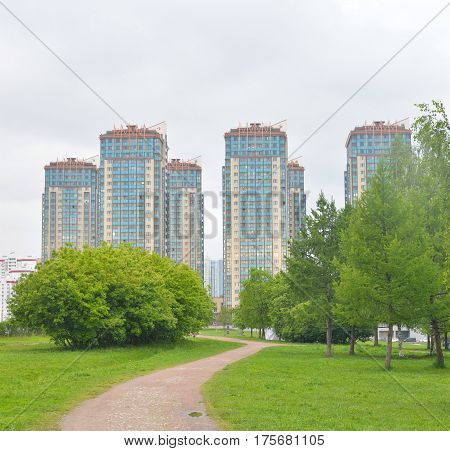 Park and modern residential building in microdistrict Ribatskoe on the outskirts of St. Petersburg Russia.