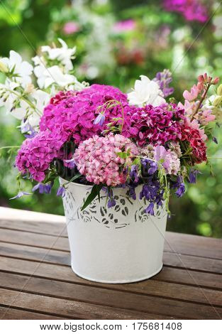 basket with beautiful flowers from the garden