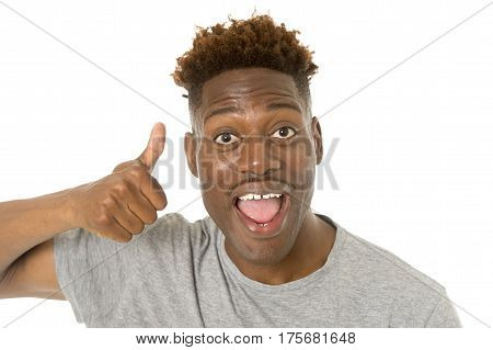 young friendly and happy afro american man smiling excited and posing cool and cheerful isolated on white background having fun looking positive in intense happiness facial expression