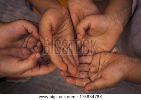Concept of poverty with many childrens hands