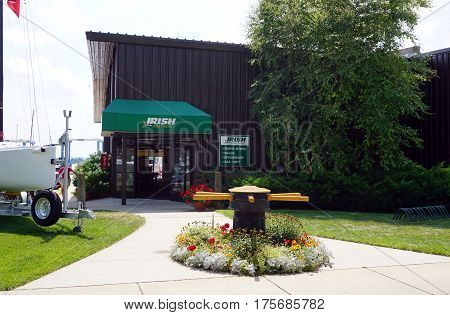 HARBOR SPRINGS, MICHIGAN / UNITED STATES - AUGUST 4, 2016: One may purchase a boat at the Irish Boat Shop, on Bay Street in Harbor Springs.