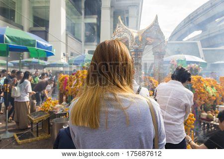 Unidentified person worship in Erawan shrine at ratchaprasong bangkok Thailand. Erawan shrine is famous place of bangkok