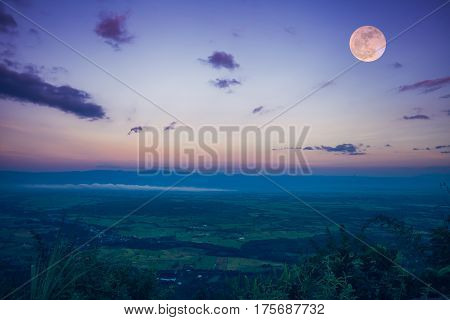 The Full Moon In The Evening After Sunset. Outdoors At Nighttime.