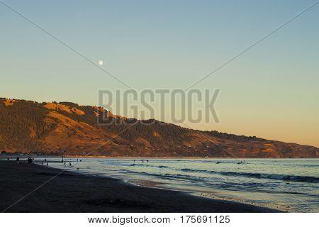 Moonrise Over A Beach