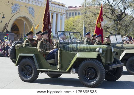 SAINT PETERSBURG, RUSSIA - MAY 09, 2015: Soviet officers in the car GAZ-67 in the parade in honor of Victory day