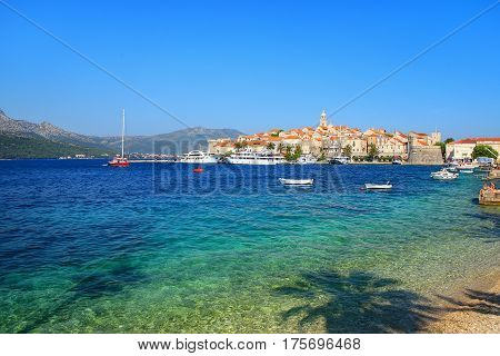 Clear water at the waterfront of Korcula town Croatia. Korcula is a historic fortified town on the protected east coast of the island of Korcula