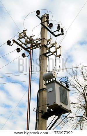 Distribution electrical transformer mounted on a pole. Distribution electrical power system. Electric utility.
