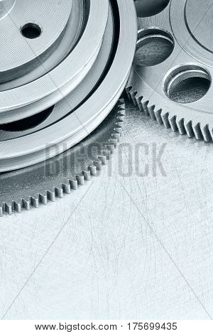 Engine Gear Cogwheels On Scratched Industrial Background Closeup
