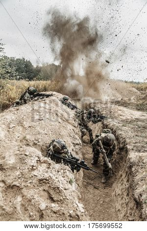 Squad of elite french paratroopers of 1st Marine Infantry Parachute Regiment RPIMA in action in enemy trenches, militants and machine gunner poster