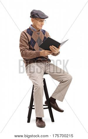 Senior sitting on a chair and reading a book isolated on white background