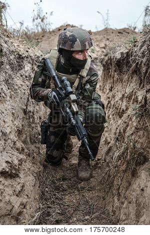 Paratrooper of french 1st Marine Infantry Parachute Regiment RPIMA in entrenchments