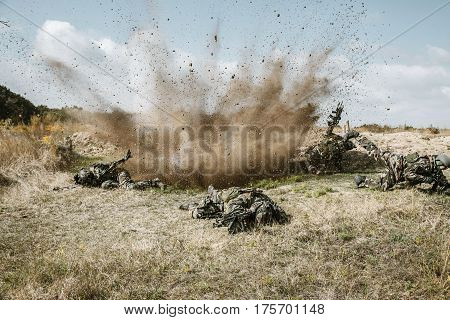 Squad of elite french paratroopers of 1st Marine Infantry Parachute Regiment RPIMA ambushed in action, landmine exploding, they are killed