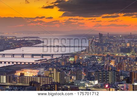 Beautiful sunset over Osaka city downtown aerial view cityscape downtown background Japan
