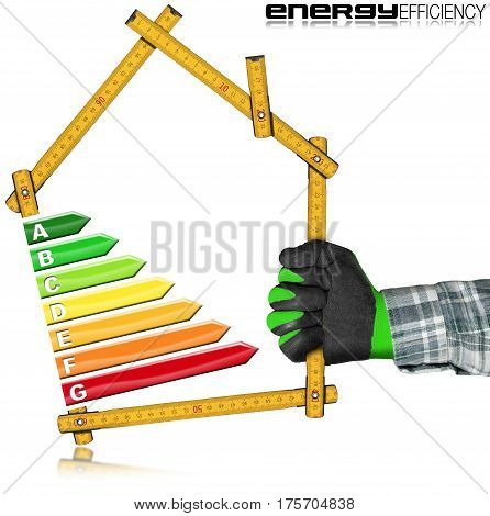 Energy Efficiency - Hand with work glove holding a wooden folding ruler in the shape of house with energy efficiency rating. Isolated on white background