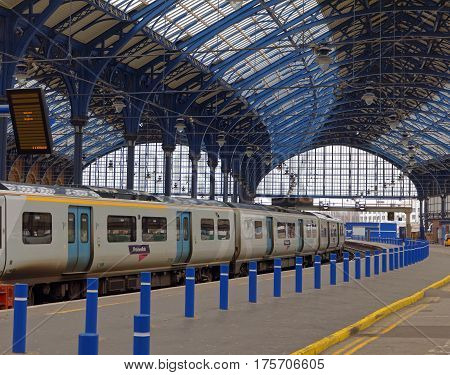 BRIGHTON GREAT BRITAIN - MAR 01 2017: Two trains in the beautiful old train station in Brighton UK. March 01 2017 in Brighton Great Britain