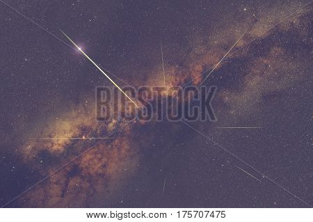 Milky way stars with meteor shower trails on the sky.
