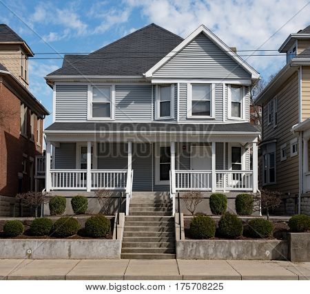 Gray House in Urban Neighborhood