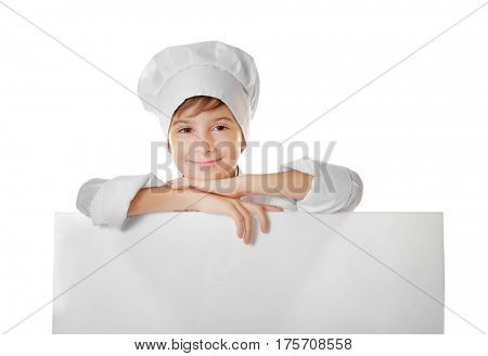 Cute boy in chef uniform with poster on white background