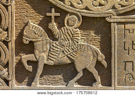 Ornamental knot and the horse and rider. The works of Armenian cross-stones - khachkarsmedieval Christian artworld heritage of UNESCO.