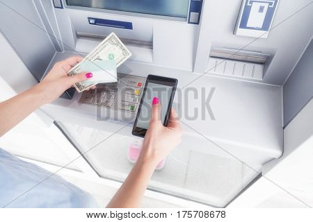 ATM / bank money withdrawal and cellphone technology.