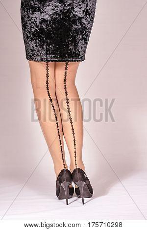 slender womens legs with high heels in studio