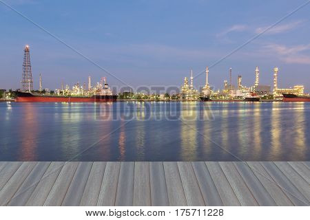 Opening wooden floor panorama oil refinery light river front industrial lanscape background