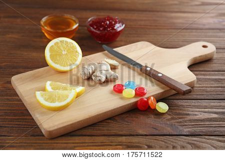 Cough drops with ginger and lemon on cutting board