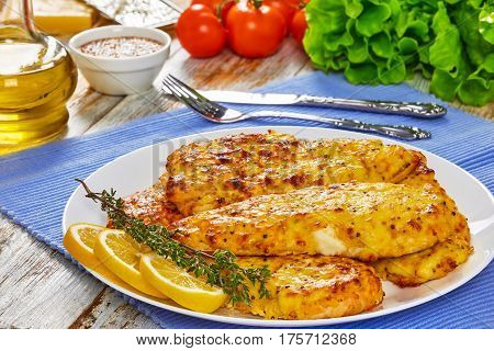 Baked Chicken Breas On White Plate