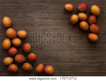 Apricots on the board background. Apricots on the board background