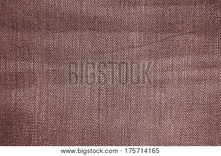 Brown texture of jeans textile close up. Blank backdrop for design. Multicolor background set.