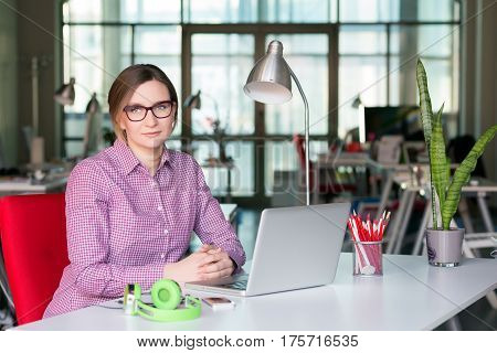 Sophisticated Business Lady in smart casual Style Clothing working at modern Digital Office Interior