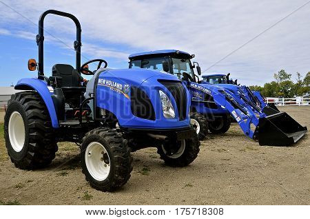 WEST FARGO, NORTH DAKOTA, September 13, 2016.New Holland tractors and agricultural equipment are displayed at the Big Iron Farm Show held annually at the Red River Fairgrounds each September.