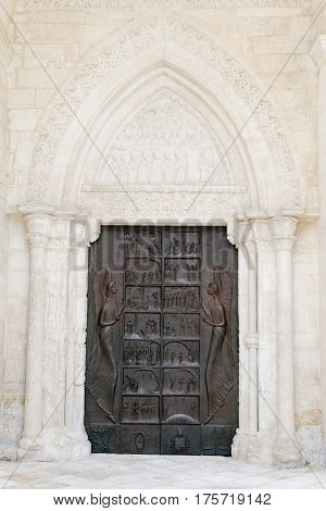 Monte Sant'Angelo, Italy - 28 June 2016: Entrance door of St Michael basilica at Monte Sant'Angelo on Puglia Italy