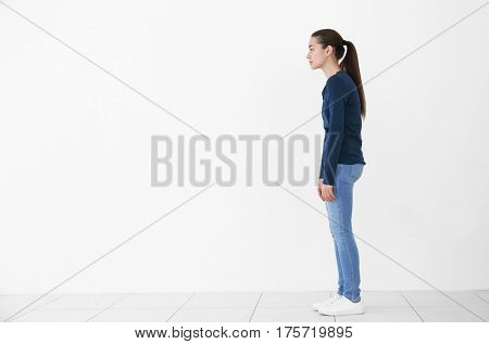 Posture concept. Young woman on white wall background