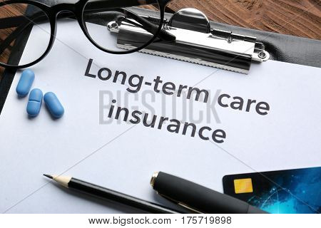 Text LONG-TERM CARE INSURANCE on clipboard