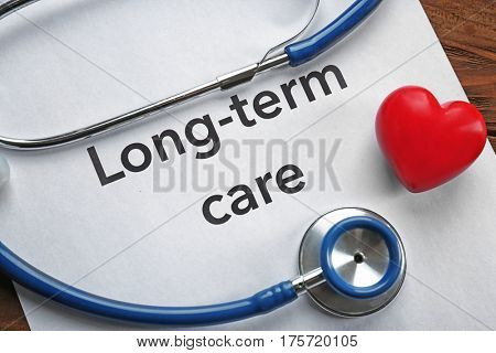 Stethoscope and paper sheet with text LONG-TERM CARE, closeup
