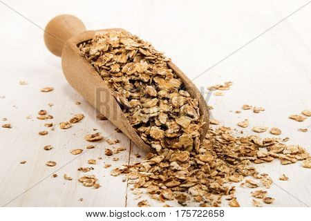 roasted and warm oatmeal on a wooden scoop