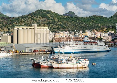 Port Louis Mauritius - December 12 2015: View of the Bulk Sugar Terminal and MV Logo-s Hope ship in Port Louis Capital of Mauritius. Fishing Vessels in the foreground.