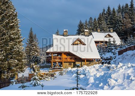 Volosyanka village Ukraine - February 8 2017: Carpathian winter landscape. Snowy alpine village on picturesque winter mountainside resort place Volosyanka village Lviv region Ukraine.