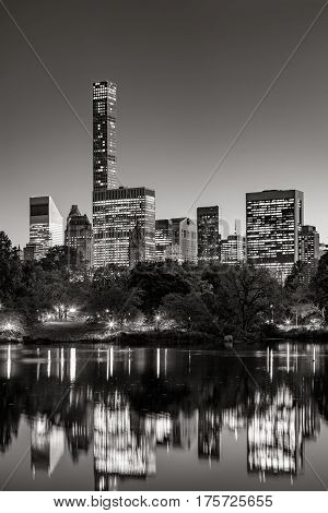Midtown skyscrapers reflecting upon the Central Park lake at twilight. Black & White. Manhattan New York City
