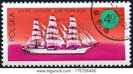 UKRAINE - CIRCA 2017: A stamp printed in Poland shows three-masted sailing ship Dar Pomorza series Ships under the Polish Flag circa 1971