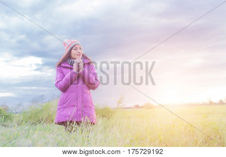 Young woman is happy with the flowers while sunset and winter is coming  Stock photo ID: 593100362  Young woman is happy with the flowers while sunset and winter is coming