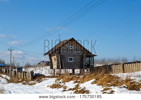 Village of Muja, Kirovsky district, Leningrad region, March 6, 2017: unusual and cute the house of the North in winter. Wooden house on legs. Rural settlement of the Northern peoples.