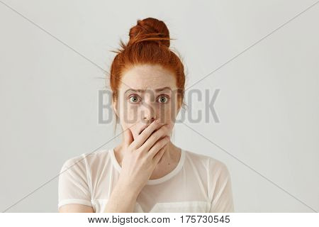 Scared And Shocked Bug-eyed Pretty Girl With Orange Hair Having Surprised And Astonished Facial Expr