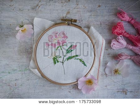 beautiful delicate flower embroidered cross-stitch in the Hoop rustic still life