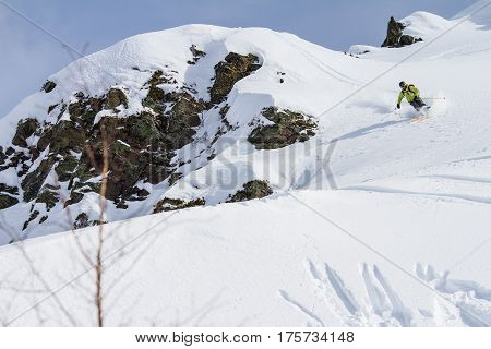 The freerider moving down the slop of the mountain