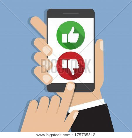 Website rating feedback and review concept. Hand holding and pointing to a smartphone with like and dislike